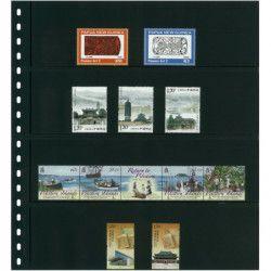 Feuilles de classement Omnia Lindner à 4 bandes pour timbres-poste.