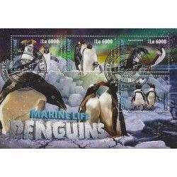 Les penguins bloc-feuillet de 4 timbres thématiques.